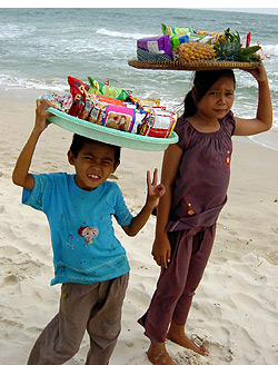 children selling snacks at a beach in Sihanoukville, Cambodia