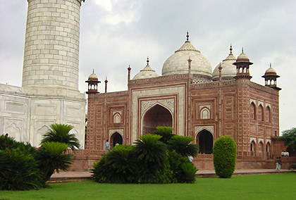 a view of one of the red sandstone buildings at the wings from near the Taj Mahal's square base
