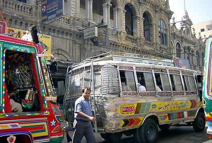mini buses on a crowded street in Karachi