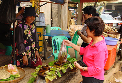 Filipinos buying snacks at a market stall, Phnom Penh