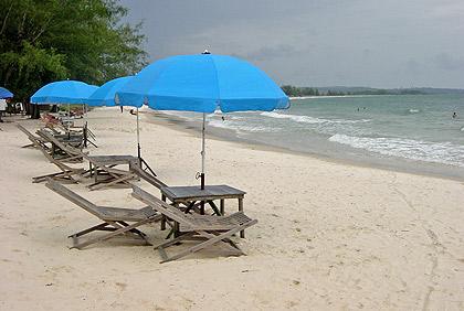 blue beach umbrellas and cots at Occheuteal Beach, Sihanoukville