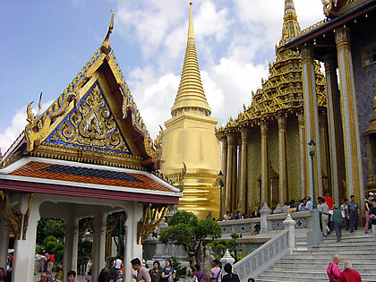 structures inside the Grand palace complex in Bangkok: the steps of the Prasat Phra Thap Bidon in the right foreground with the Phra Si Rattana in the background