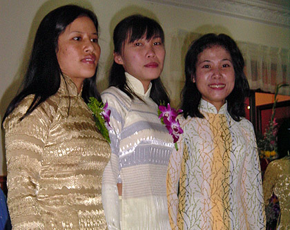 3 Vietnamese ladies wearing the native Áo dài at a special occasion
