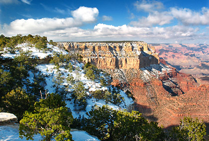 multi-colored canyon walls draped in snow as viewed from Yavapai Point