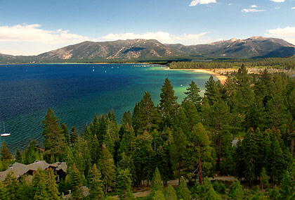 the South Shore of Lake Tahoe with evergreen forest in the foreground