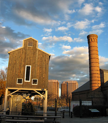 a view of old buildings at the Tredegar Ironworks with modern buildings in the background, Richmond, Virginia