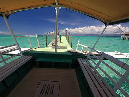 interior of motorized outrigger boat used for dolphin-watching tours, Bais