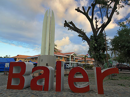 Baler 400 Years monument behind large signage