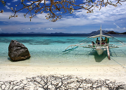 motorized outrigger anchored on Banol Beach, Coron