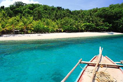 outrigger boat approaching Dalutan Island, island province of Biliran