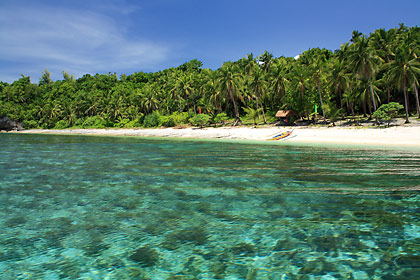 coral gardens and white sand beach on the eastern shore of Higatangan Island, Biliran
