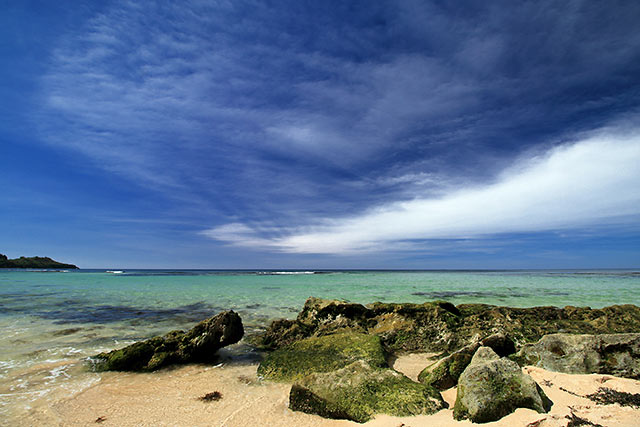 rocks, turquoise waters and blue skies at Cabo Beach