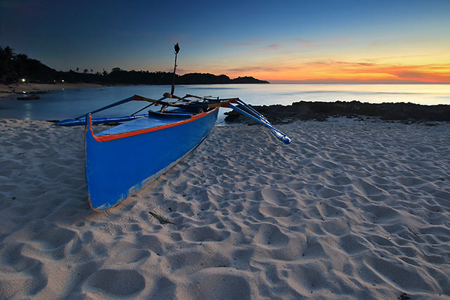 boat during sunset at Cabo Beach