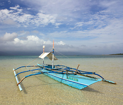 outrigger boat anchored off Cagbalete's shallow port