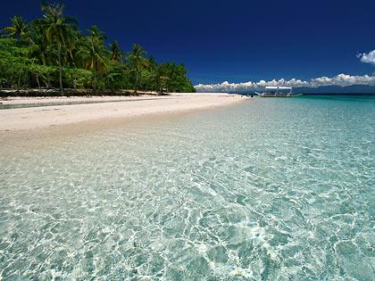 white sand beach and crystal-clear waters at Mahaba Island, Cuatro Islas