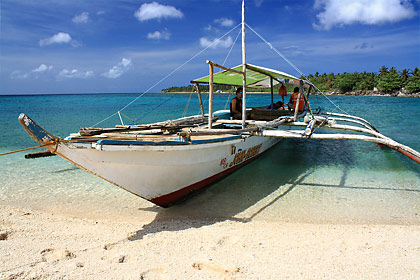 Our outrigger moored at the sandbar of Higatangan Island, Biliran