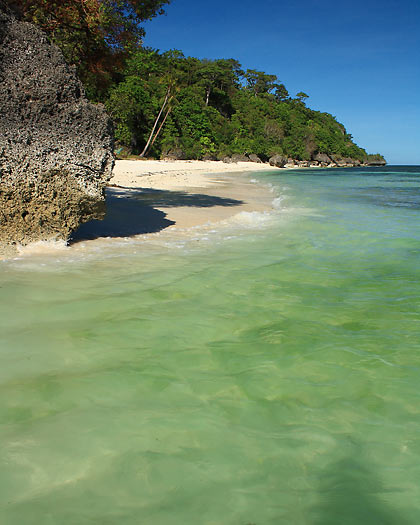 rock formations, white sand and turquoise waters of Kagusuan Beach