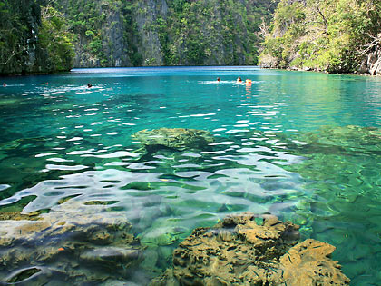 emerald green waters and karst formations at Kayangan Lake