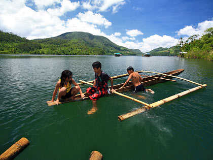 children playing on dugout canoe, Lake Danao