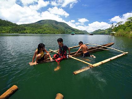 children playing on dugout canoe, Lake Danao