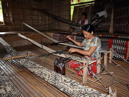 T'boli woman weaving tinalak cloth