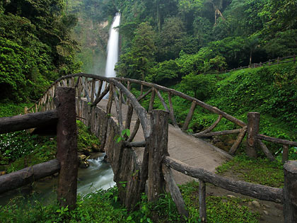 arched bridge over a stream at Hikong Bente Falls