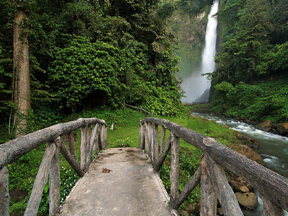 arched bridge leading to Hikong Bente Falls