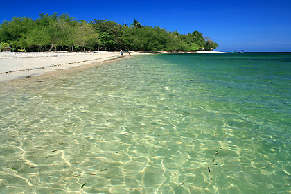 light beige sandy beach and emerald green waters of Magalawa Island