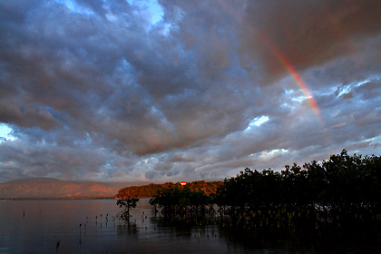 rainbow over Palauig viewed from Magalawa Island's mangrove area