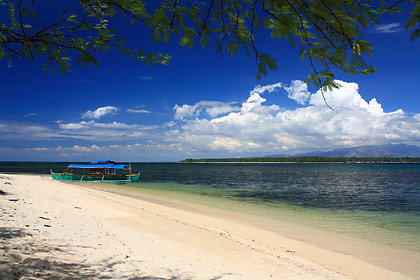 the beachfront of Ruiz Resort, Magalawa Island, with San Salvador Island in the background