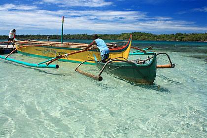 boatmen at a sandbar near San Salvador Island, Masinloc