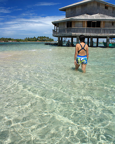 wading at the sandbar off San Salvador Island, Masinloc