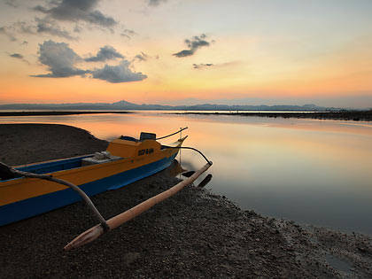 a boat at sunset, Ormoc city pier