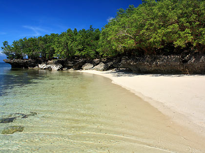 coral rocks and clear waters, Paliton Beach