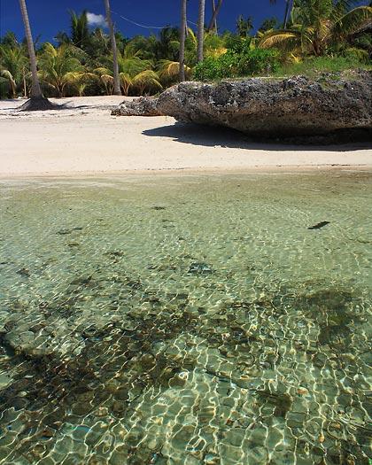 crystal-clear waters at Paliton Beach, San Juan