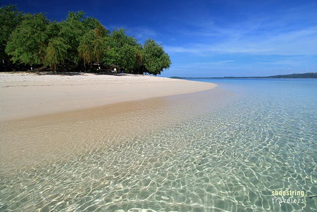 walking on Potipot's creamy white sand beach