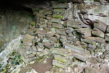 Lumiang Burial Cave showing stacks of coffins at its opening