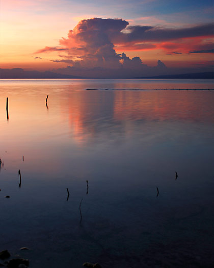pastel-colored sunset scene at Larena's Sandugan Beach