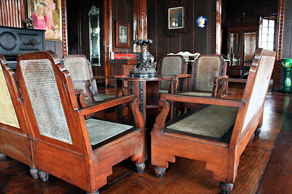 interior of the Apacible House featuring antique wooden furniture and narra flooring, Taal