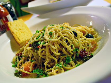 pesto spaghettini with anchovies, black olives and tomato fusilini