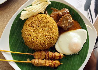 beef rendang, sate ayam, fried rice and kerupuk