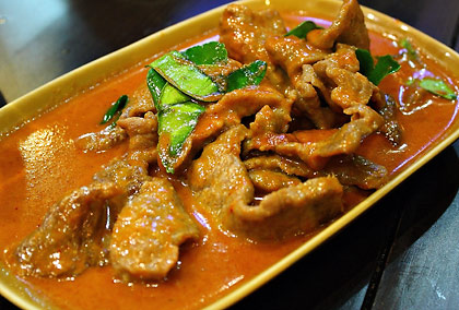 a plate of beef panang curry at a Thai restaurant