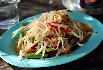 a plate of green papaya salad in an eatery in Chiang Mai