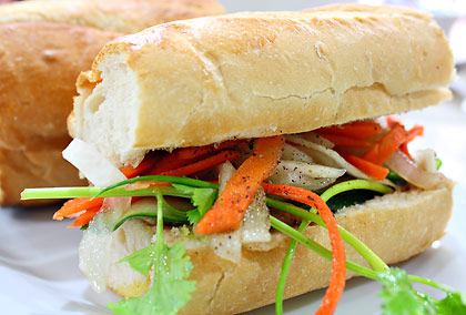 a bahn mi or Vietnamese baguette with vegetables and grilled meat