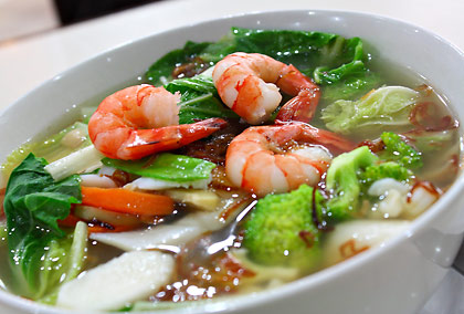 a bowl of seafood pho at a Vietnamese restaurant
