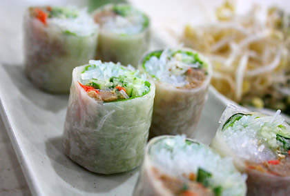 goi cuon or summer rolls cut into little sections and served as an appetizer